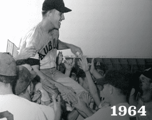 1964 Overton being lifted onto teammates' shoulders