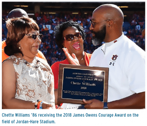 Chette Williams '86 recieving the 2018 James Owens Courage Award on the field of Jordan-Hare Stadium