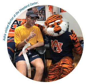 Cole Burton and Aubie when Aubie visited Burton at the Shepherd Center