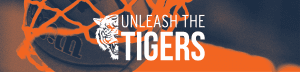 Unleash the Tigers basketball going into the basket