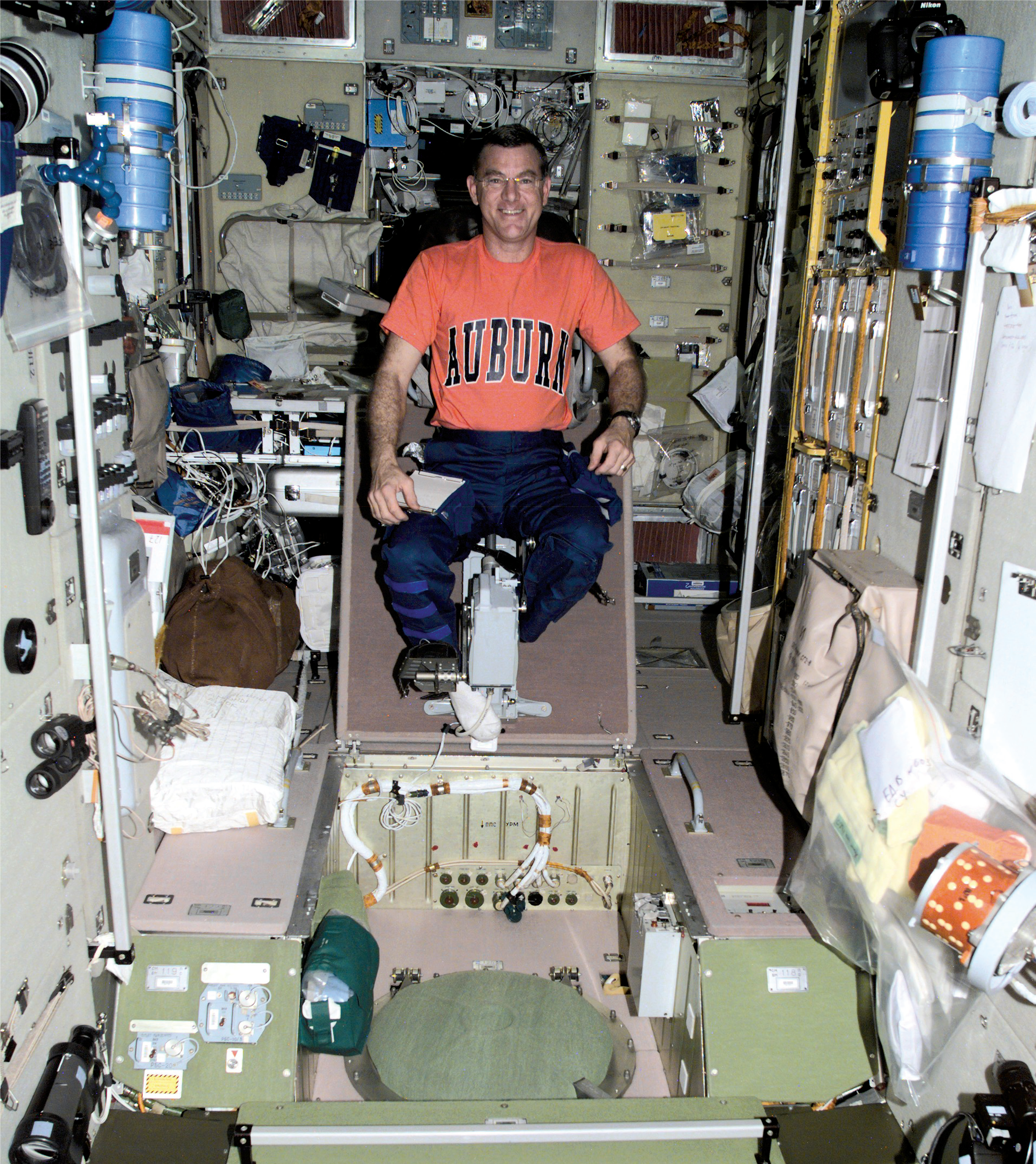 Jim Voss '72, Expedition Two flight engineer, prepares to exercise on the cycle ergometer in the Zvezda Service Module on March 23, 2001.