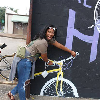 Natalie Walker pose with bicycle photo