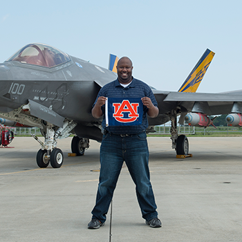 Duriel Holley standing infront of jet picture