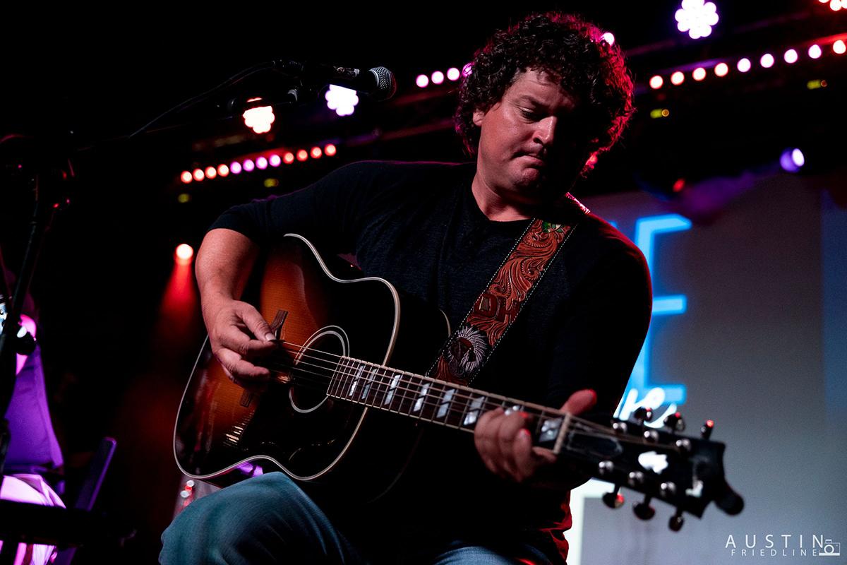 Dustin Herring sings and plays guitar.