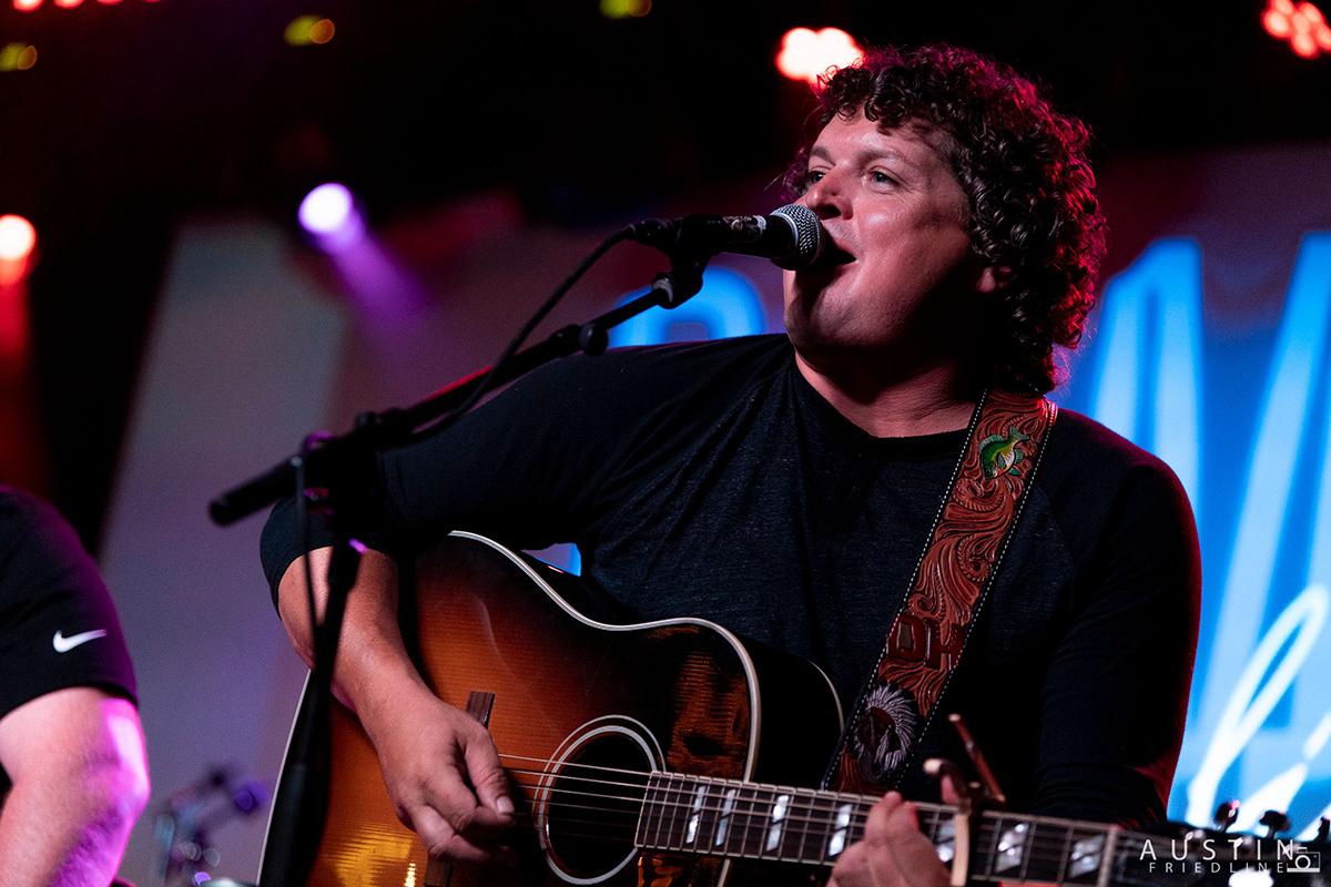 Dustin Herring sings and plays his guitar.
