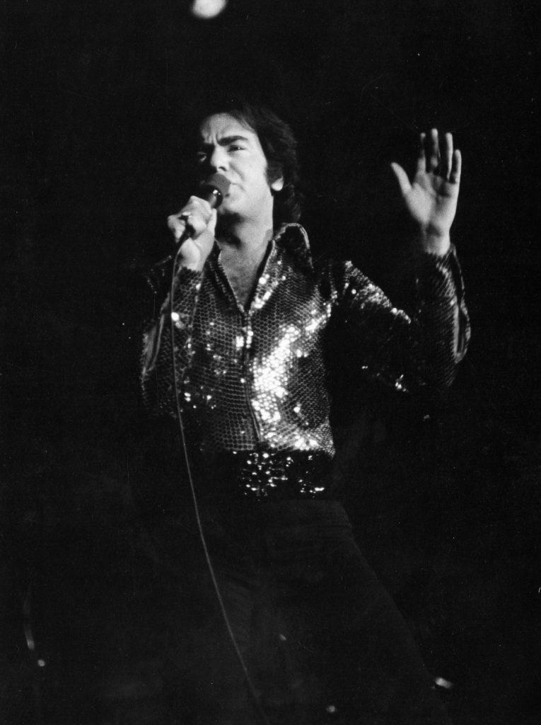 Neil Diamond on stage singing