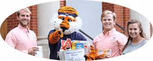 Students standing with Aubie for Food Pantry
